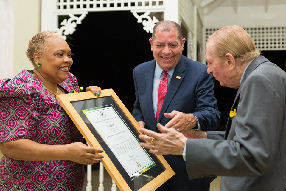 Sharing the moment with the Hon. Audley Shaw, Minister of Industry, Commerce, Agriculture and Fisheries, Miss Veira presents Keynote Speaker and special guest, the Most Honourable Edward Seaga with a citation during the re-opening of Things Jamaican last year.