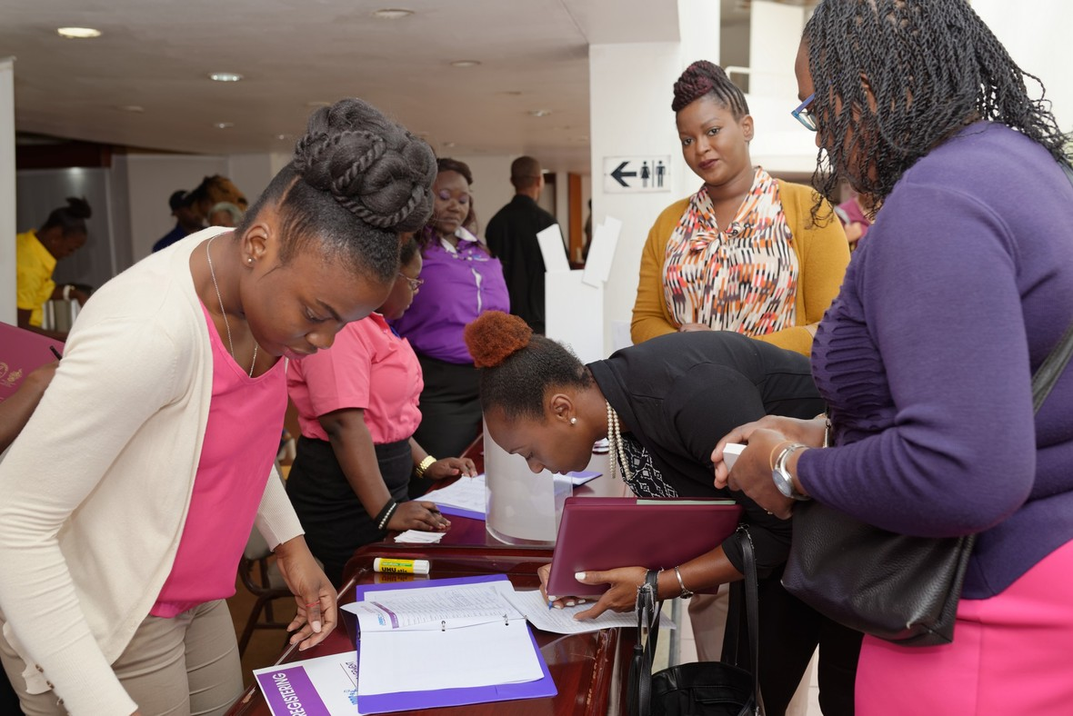 Excited participants register before entering Kenneth Rattray Room at the Jamaica Conference Centre where the JBDC's inaugural Employee Engagement Conference was held on Tuesday, October 31, 2017